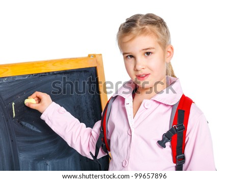 Schoolgirl writing on a blackboard, isolated on white - stock photo