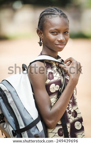 Schooling Symbol: Young African Girl Going to School With Sack (Schooling Education Symbol) - stock photo