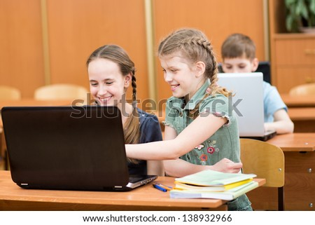 schoolkids using laptop at lesson - stock photo
