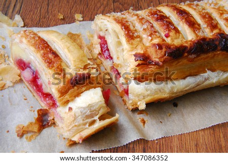 schtrudel pie on wooden table - stock photo
