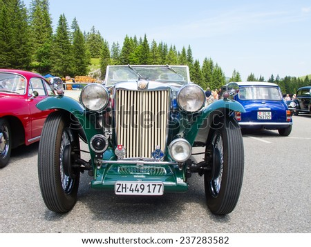 """SCHWAEGALP - JUNE 27: Morgan MG Plus Four car on the 7th International """"Oldtimer meeting"""" in Schwaegalp, Switzerland on June 27, 2010. Around 4'500 """"Morgan +4"""" was produced between 1950 and 1961. - stock photo"""
