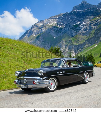 """SCHWAEGALP - JUNE 27: The Buick Imperial leaving the 7th International """"Oldtimer meeting"""" in Schwaegalp, Switzerland on June 27, 2010 - stock photo"""