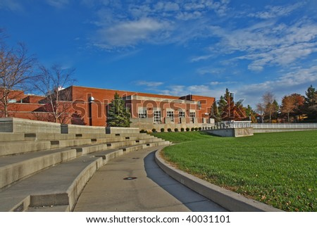 Schwitzer Student Center and part of an outdoor amphitheater on the campus of the University of Indianapolis in Indiana with blue sky and white clouds
