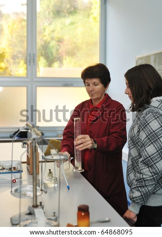 science and chemistry classees at school with smart children and teacher - stock photo