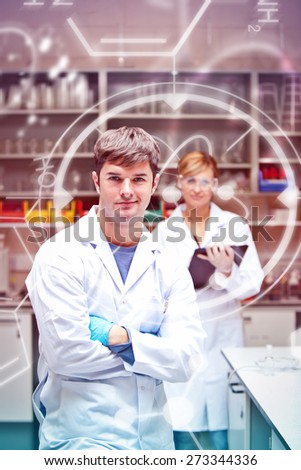 Science and medical graphic against two serious scientists looking at the camera standing - stock photo