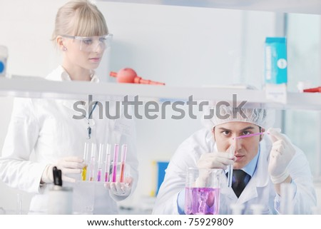 science and research biology chemistry and medicine  young people couple in bright modern  lab - stock photo