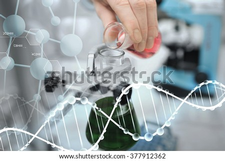 science, chemistry, biology, medicine and people concept - close up of scientist hand filling test tubes and making research in clinical laboratory  over dna molecule structure  - stock photo