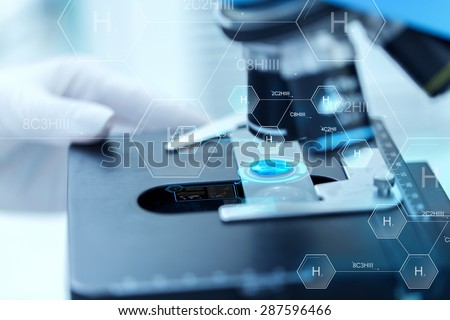 science, chemistry, biology, medicine and people concept - close up of scientist hand with test sample making research in clinical laboratory over hydrogen chemical formula - stock photo