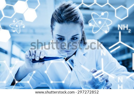 Science graphic against beautiful serious scientist pouring liquid - stock photo
