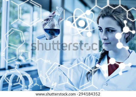 Science graphic against chemist looking at a blue liquid - stock photo