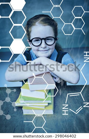 Science graphic against cute girl with stack of books in classroom - stock photo