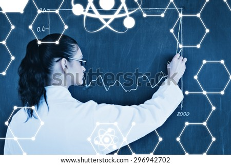 Science graphic against darkhaired scientist drawing a graph on the blackboard - stock photo