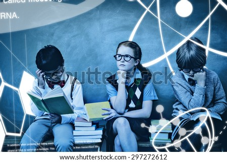 Science graphic against kids with stack of books in classroom - stock photo