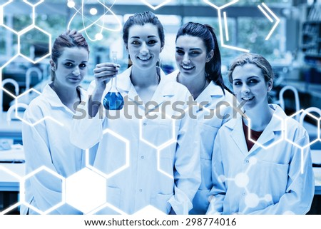 Science graphic against lab partners posing with a flask - stock photo