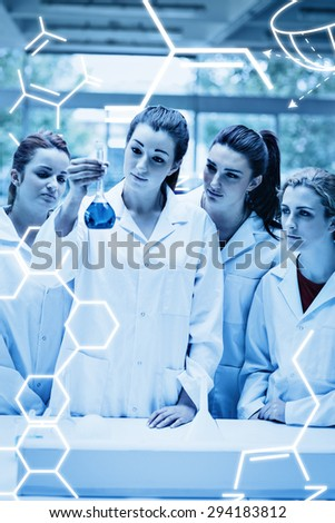 Science graphic against portrait of science students looking at a flask - stock photo