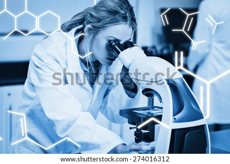 Science graphic against science student looking through microscope in the lab - stock photo