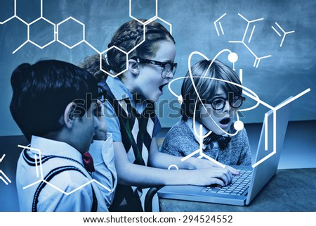 Science graphic against shocked little school kids using laptop - stock photo