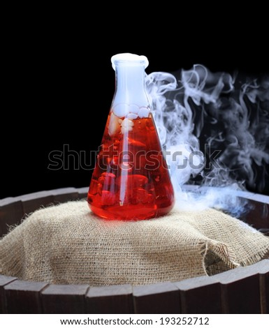 Science lab experiment with smoke coming from the flask - stock photo