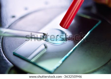 Science laboratory pipette with samples liquid, close up - stock photo