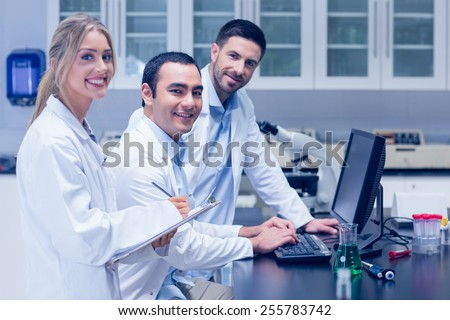 Science students working together in the lab at the university - stock photo