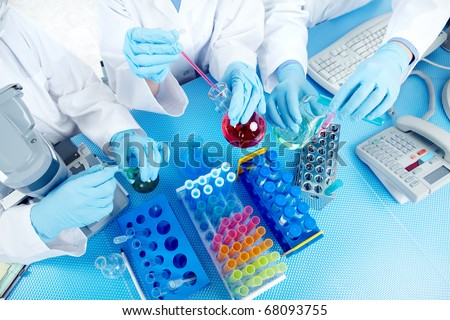 Science team working with test tubes at  laboratory - stock photo