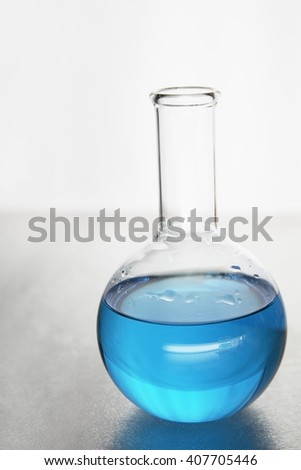 Science tube with colored liquid inside over white background - stock photo