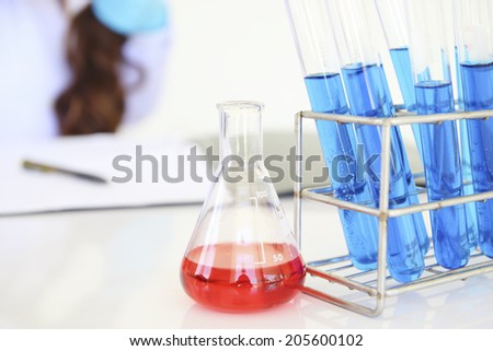 scienctis working in laboratory - stock photo