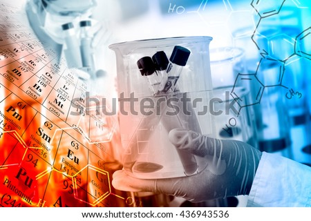 Scientific concept, gloved hand hold a beaker in laboratory room with periodic table and chemical structure background  - stock photo