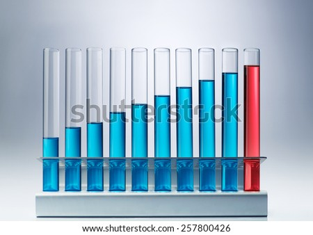 Scientific research. Bar chart made of blue liquid in test glasses - stock photo