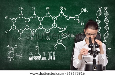 scientific researcher woman studying the chemical sample - stock photo