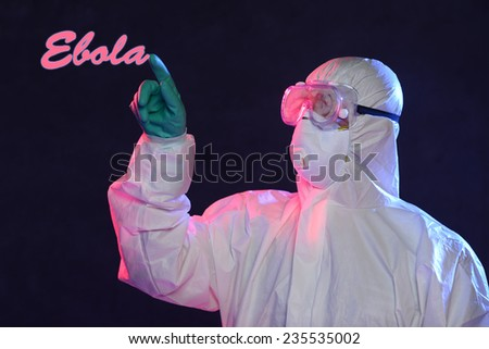 Scientist in protective hazmat suit writing the word Ebola - stock photo