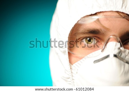 Scientist in protective wear, glasses and respirator - stock photo