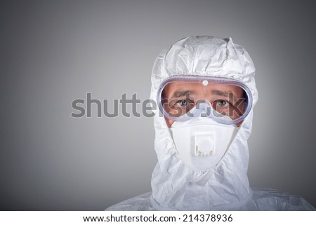Scientist in protective wear, glasses, respirator - stock photo