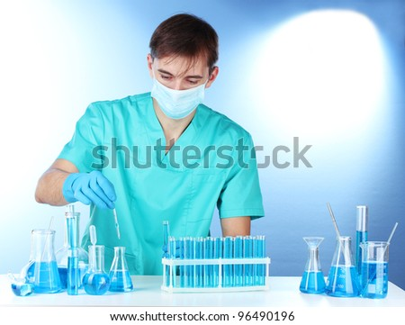 scientist in the lab working with chemicals test-tubes - stock photo
