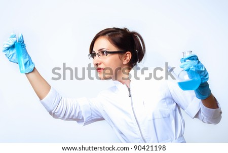 Scientist in uniform doing tests in laboratory