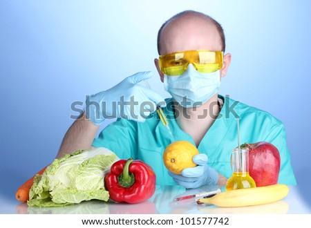 Scientist injecting GMO into the lemon - stock photo