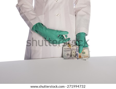 Scientist injecting money in the labratory - stock photo