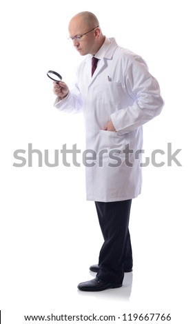 scientist looking through a magnifying glass - stock photo