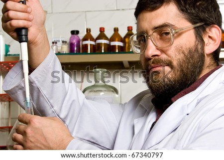 Scientist making tests in lab - stock photo