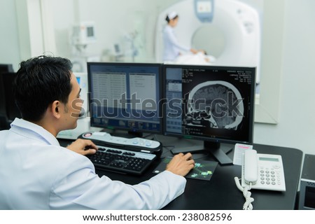 scientist Scanning the brains of patients with a Ct scan - stock photo