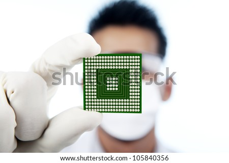Scientist showing a microchip computer, shot in studio - stock photo