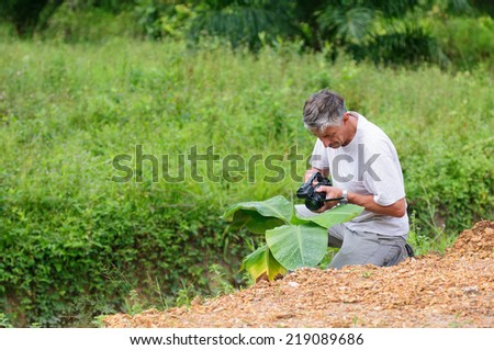 Scientist with camcoder studying plant desease - stock photo