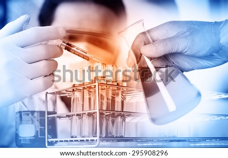 scientist with equipment and science experiments ,Laboratory glassware containing chemical liquid, science research - stock photo