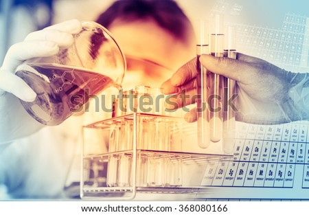 scientist with equipment and science experiments ,Laboratory glassware containing chemical liquid, science research,science background - stock photo