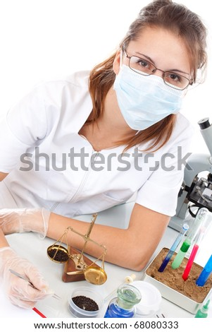 Scientist woman and measure balance in laboratory - stock photo