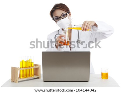 Scientist woman mixing formula to make an experiment - stock photo