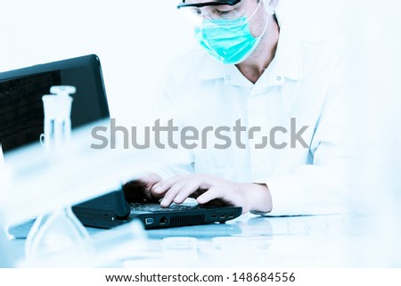 scientist working at the laboratory. - stock photo