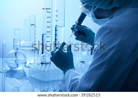 scientist works at the laboratory - stock photo