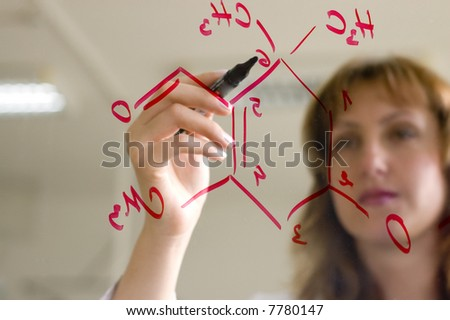 scientist writing a formula - stock photo