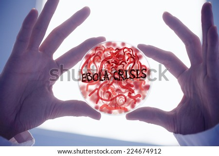 Scientists hands holding petri dish of germs low angle view stock
